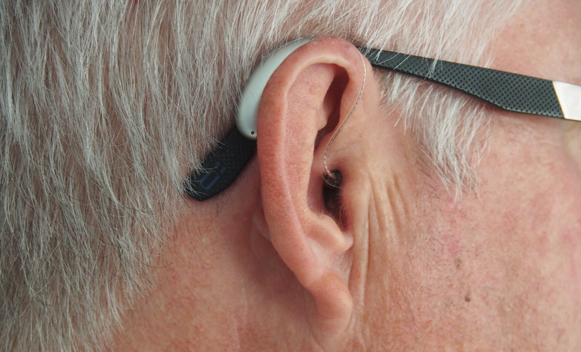 Hearing aid with glasses